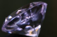 Glassy-looking diamonds form nearly 100 miles beneath the Earth's surface.