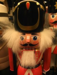 The nutcracker is decorative, with rich, vibrant colors.