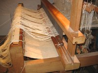 A large loom is used to make handcrafted textiles.