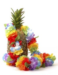 Pineapples and leis provide festive decor for a luau.