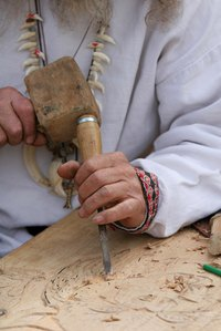 A wood carver at work.