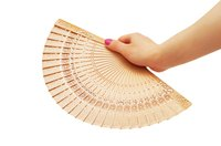 Create your own Chinese fans from paper and popsicle sticks.