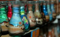 Jars of colored sand.