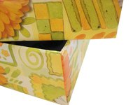 Cover cardboard boxes with fabric.