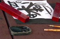 Use ink and a bamboo brush to make traditional Chinese scrolls.