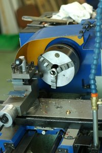 Cutting oil is used when machining parts on devices such as lathes.