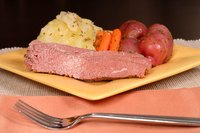 Corned beef is often accompanied by cabbage and root vegetables.