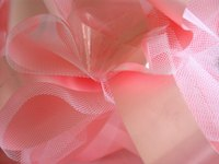 Make butterflies out of tulle fabric.