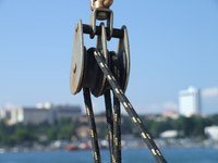 Use a pulley to turn a large tripod into a lifting machine.