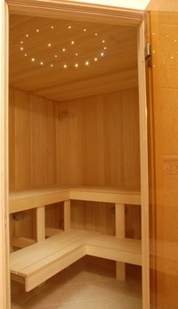 Clean sauna wood with mild detergent and water.