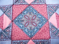 An intricate variation on the traditional Ohio Star quilt pattern