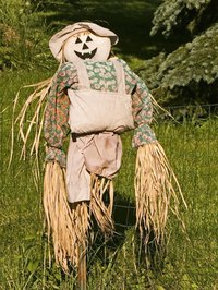 Creating a personalized scarecrow can be a family project.