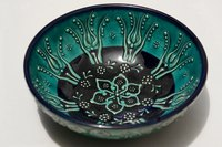 Chinese cloisonné is known for its beautiful designs and bright colors.