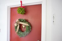 Decorate your front door for the holidays.
