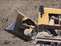 A track bulldozer with a combination blade is a versatile machine.