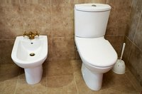 Clean difficult toilet stains with vinegar and baking soda.