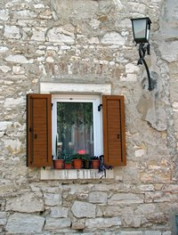 Pella casement and awning windows can be adjusted with a pull-out handle.