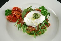 Poached eggs are an ingredient in many recipes.