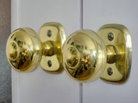 Update a brass doorknob using spray paint.