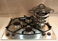 A clean stainless steel stove top.
