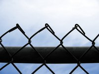 Drawing a chain link fence can be broken down into simple steps.