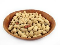Roasting raw peanuts makes them crunchy and flavorful.