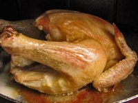 The juices at the bottom of the baking pan add flavor to chicken gravy.