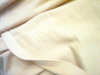 Hand wash yellowed linens.