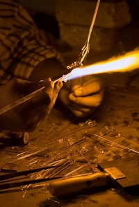 You can light a blow torch with a standard lighter.