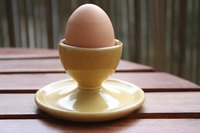 Hard-boiled eggs should be cooled immediately and then cracked on a hard surface.