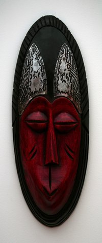 Many folk artists imitate the features on a Zulu mask.