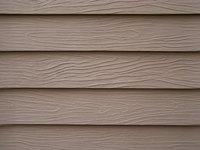 Vinyl siding snaps in place to create a waterproof barrier.