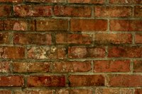 Cover old exposed brick with tile.