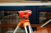 A tripod mounted level can be moved to various locations to provide increased accuracy.