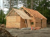 Use the angle from the peak of your roof to cut rafters vertically.