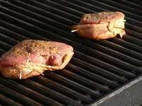 Make tuna steaks on a gas grill for a summer meal.