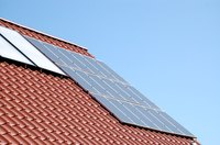 A large solar installation mounted on a roof can contribute substantially to the power used by a residence.