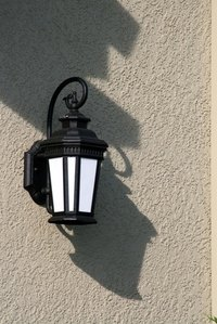 A dusk to dawn lamp adaptor makes your porch lights operate automatically.