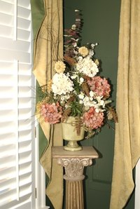 A decorative pedestal gives you a place to showcase your personal artistic treasures.