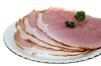 Serve sliced spiral ham at holiday dinner parties.