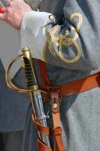 A Confederate officer presentation may include gold braid on the cuffs and a saber.
