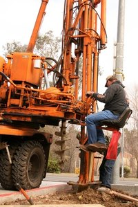 Certified well drillers use an auger drill rig to remove well casing from the subsurface properly.