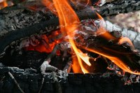 Enjoy the warmth of a fire on a scenic hill by building a fire pit.