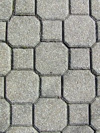 Interlocking paving stones may be arranged without mortar.