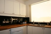 Painting flat kitchen cabinet doors refreshes the look of your kitchen.