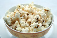If you are adventurous, try popping popcorn with butter instead of oil.