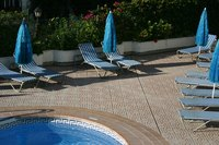 Tile adds an attractive feature to fiberglass pools.