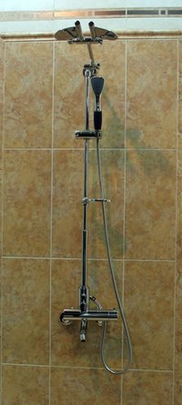 The basic elements of a shower are the drain, handles and spout.