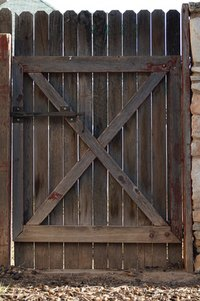 Make your wood gate twice as wide to accommodate large machinery.