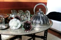 A tarnished silver  teapot may benefit from a soak with a Silver Lightning plate.